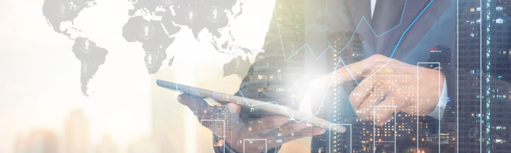 47493307 - double exposure of businessman using the tablet with cityscape and financial graph on blurred building with world map and people logo background, elements of this image furnished by nasa